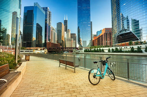 Bike parked along the Chicago Illinois city riverwalk and rive